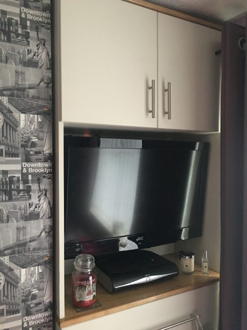 Tall Boy with built in TV and upper cupboards